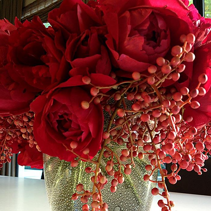 red garden roses arranged